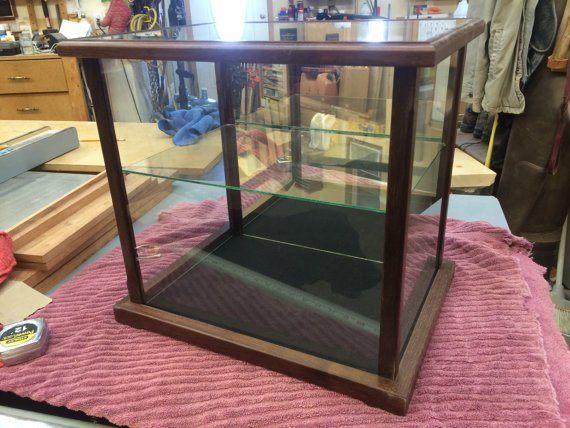 walnut glass display case with shelf
