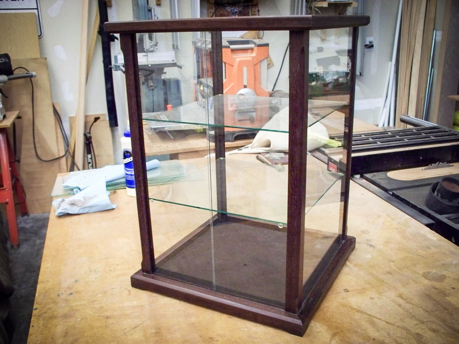 Handmade Peruvian Walnut Display Case With Adjustable Shelves And Glass Sliding Door