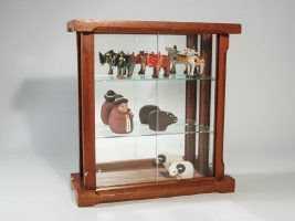 figurines in curio cabinet