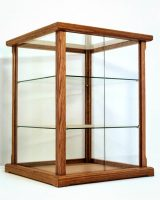 Wood and glass display case with shelves