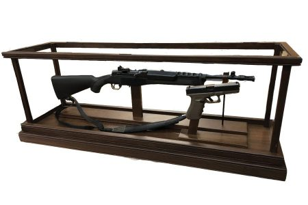 custom gun display case holding rifle and pistol